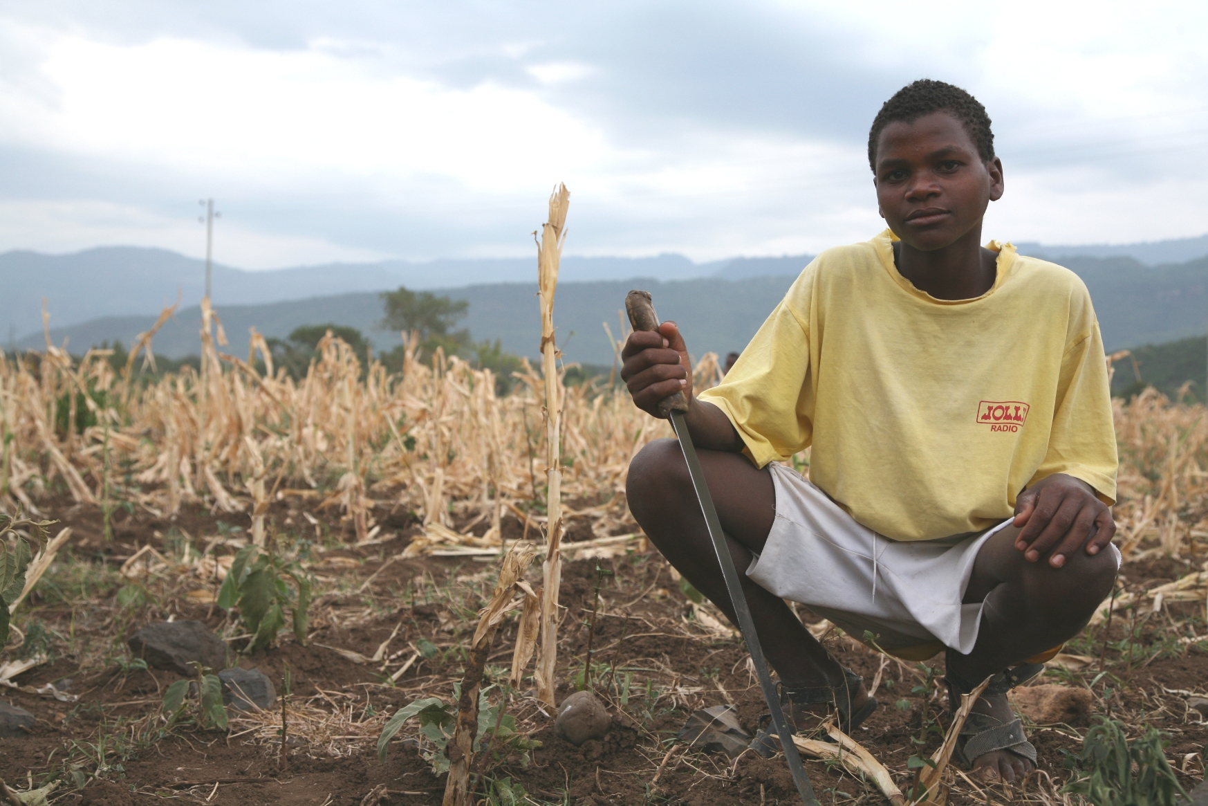 A young man in drought conditions in Ethiopia